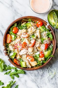 This delicious, Chicken Brown Rice Bowl is an easy one-bowl meal with chicken breast, arugula, avocado, tomatoes, Gruyere with a sriracha yogurt sauce. #bowls #chickenbreast #chickenbowl