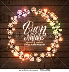 Merry Christmas and Happy New Year. Italian Language. Glowing Christmas Lights Wreath for Xmas Holiday Greeting Card Design. Wooden Hand Drawn Background.