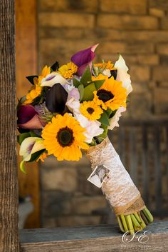 Gorgeous summer wedding bouquet with sunflowers and calla lilies perfect for a rustic wedding