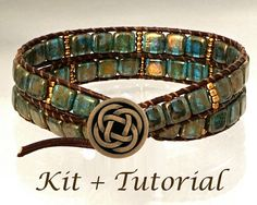 The Deep Forest Mysteries wrap bracelet jewelry kit features a sophisticated yet easy beginners beading project. It includes Czech 2-hole square beads in transparent zircon blue with a gold wash on the surface. The antique brass colored Toho beads, dark brown leather and thread, and deep antique bronze button all add to the rich tone of this double wrapped bracelet. Choose from 3 variations with different buttons: ~The Celtic Knot button ~The Antlers & Swirls button ~The Fleur de Lis button…