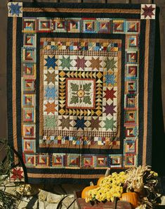 """Autumn Splendor Quilting Pattern from the Editors of American Patchwork & Quilting 1996.  Bring the colors of fall to life with a delightful, scrappy sampler quilt. There's a little bit of everything here, including applique, Log Cabin blocks, Flying Geese, Star blocks, and Four-Patches. Finished quilt: 80x96"""". Finished blocks: 8"""" square. Designer: Alice Berg."""