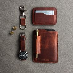 """Matching Bas and Lokes saddle tan handmade leather accessories. """"Ford"""" slim leather wallet, Moleskine/Fieldnotes sleeve and key fob. Watch strap paired with Omega Speedster 3592.50. Accessories available at www.basandlokes.com-SR"""