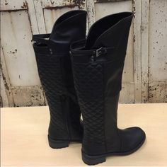 Black knee high riding boots Beautiful boots with quilted looking back. Comes to knee. Zipper closure. Bought these beauties on posh and then my husband got me another pair for Christmas. Brand new! Never worn! Boutique Shoes Winter & Rain Boots