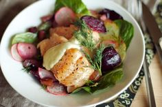 Warm steelhead trout and roasted beet salad with guanciale, crispy potatoes, radish and dill. Topped with dijon mayonnaise.