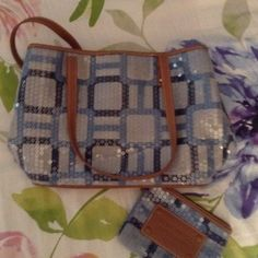 Reduced! - Two Piece Blue Handbag Darling blue bag covered in clear sequins to give it a touch of glam. Two pieces include the purse and the make-up bag. Gently used! Nine West Bags