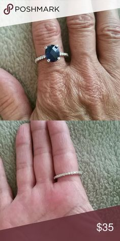 Beautiful Sapphire Ring Mint condition!  Man made stones.  Believe size is 6.5 or 7. Inside ring is stamped N V8. Not sure what that stands for. Smoke free home! Make me an offer! Get a good discount when you bundle! Jewelry Rings