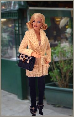 Barbie Knits! Find Knits for Barbie Doll: 75 Fabulous Fashions for Knitting by Nicky Epstein @ the Library at Call #: 746.432 EPS in the Adult Nonfiction Collection.