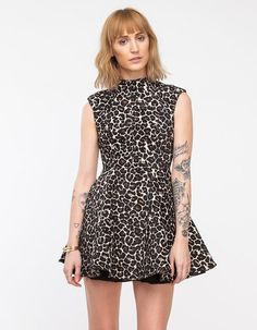 A textured, jacquard woven dress from Cameo in an exclusive leopard pattern. Features a structure...