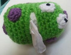 Crochet Dynamite: Hospital Germs - This is my cartoony version of a cold germ.  I thought that the next time I get sick I will really appreciate that    the little guy looks like he feels sorry about it. And it's a good reminder for Mims to wash/sanitize her hands after blowing her nose to keep the germs from spreading.  The Germ Tissue Holder