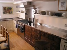Kitchen with Dresser-Style Drawers and Stainless Steel Countertops - Bespoke Kitchens by Holloways of Ludlow