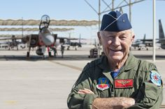 """""""Happy 65th Anniversary"""" to an American Hero! USAF Brig. Gen. Charles E. """"Chuck"""" Yeager, retired, poses for photographers after returning from his 65th anniversary of breaking the sound barrier flight aboard a 65th Aggressor Squadron F-15D Eagle piloted by Capt. David Vincent, 65th AGRS, at Nellis Air Force Base, Oct. 14, 2012. Yeager became the first man to break the sound barrier, Oct. 14, 1947, over Edwards Air Force Base. (DVIDS photo by Lawrence Crespo. Used with permission.)"""