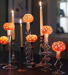 Use a drill & mini pumpkins to create this Autumn centerpiece. I haven't seen this done with mini pumpkins before. And what a great idea to have the taper go into the bottom of the pumpkin from the candlestick!