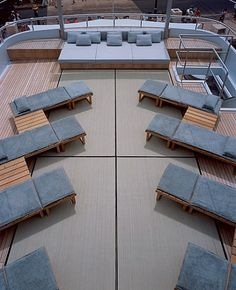 Raffia mats cover the roof deck, furnished sparsely with wood chaise longues and side tables