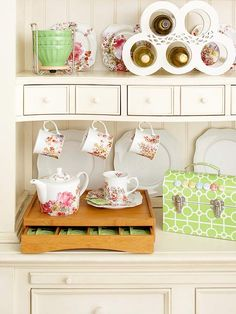 This armoire has been transformed into a handy kitchen organizer perfect for displaying pretty dishware and accessories: http://www.bhg.com/decorating/storage/organization-basics/charming-hardworking-storage/?socsrc=bhgpin011514prettykitchenstorage&page=10
