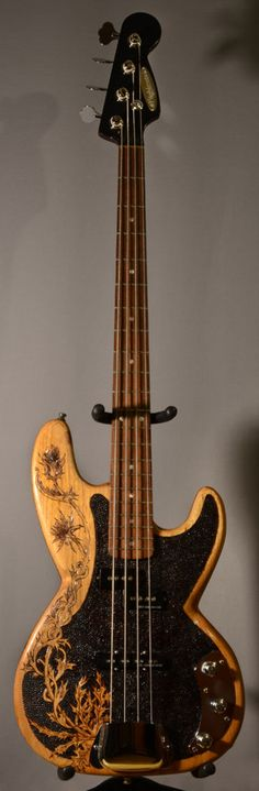 Beautiful blond wood with burned in art from one of my favorite musical instrument websites: Burnmethod Custom Highlands Bass. #DdO:) - https://www.pinterest.com/DianaDeeOsborne/basses-of-life/ - BASSes Of LIFE. Pinned via iquevega.