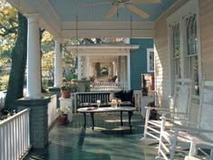 Wooden rocking chairs and a porch swing make this outdoor space the ideal antebellum retreat. Create a porch that's eye candy by mixing and matching paint colors. Photo courtesy of On the Porch