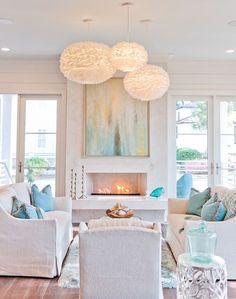 Pretty coastal living room | Dove Studio. Perfect design for an Optimyst cassette electric #fireplace