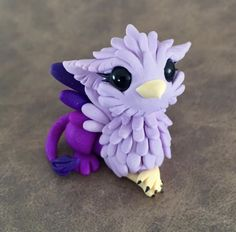 Pretty purple gryphon by Dragonsandbeasties