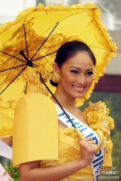 Philippine beauty queens always have the most amazing ternos. I like the flower detail on the sleeve area.  Matching parasol completes the ensemble.