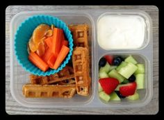 Leftover homemade whole-wheat waffles, oranges/carrots, honey dew melon with strawberries and blueberries, and (to dip the waffles into) plain yogurt mixed with a little maple syrup and vanilla extract. - 100 Days of Real Food