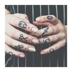 26 Simple And Striking Dotted Finger Tattoos love the eyeball