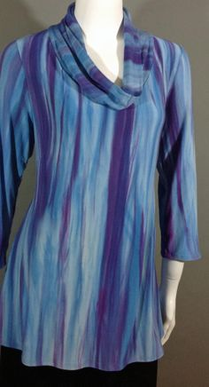 Turquoise and purple blend together to make the pattern for this Shibori, hand-dyed Bamboo Cowl neck tunic. Easy fit with a darts in the bodice and a wider hip line. Turquoise And Purple, Color Blending, Darts, Shibori, Cowl Neck, Bodice, Bamboo, Tie Dye, Tunic