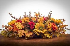 This beautiful floral can be used as a wreath, a swag or a table centerpiece. Fall floral the colors of the piece is perfect as an everyday wreath. Table Flower Arrangements, Silk Floral Arrangements, Floral Swags, Floral Centerpieces, Christmas Centerpieces, Fall Decorations, Memorial Flowers, Cemetery Flowers, Fall Flowers