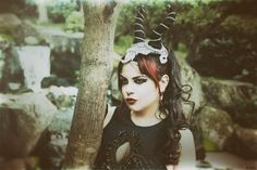 https://flic.kr/p/MUEt5u | Lurking in the shadows | Photo by Zardoz Horns made by Faerie tale Gothic Model/MUA/Stylist Azadeh Brown #fairytale #disneyvillain #villain #corset #maleficent #fascinator #victoriana #azadeh #azadehbrown #goth #gothmodel #alternative #alternativemodel #gothfashion #gothic #darkphotography #burlesque #elegant #model #modelling #vogue #persianmodel #beauty #makeup #darkbeauty #vintage #eyes #fashion #femmefatal