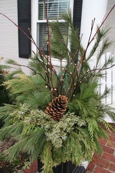 Instead of emptying your pots and hoping for an early spring, create a holiday arrangement that can add a bit of cheer through even the dreariest of months. Using natural winter greens and branches, you can create a lively splash of green in an otherwise empty container. Step by step instructions