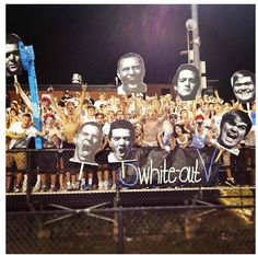 high school student section- love the idea of the big faces and the posters announcing the themes