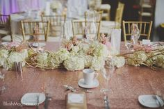 Camille & Rob's Travel Themed Wedding: Hydrangea and branch runner on sequins linen