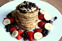 Yummy whole wheat pancakes with peanut butter, banana, berries, maple syrup and cacao nibs :)