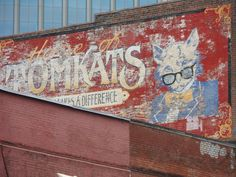 Urban Advertising and Art 000022 - a faded painted advertisement on the side of a building in Nashville, Tennessee - Tomcats a white cat in a suit wearing glasses