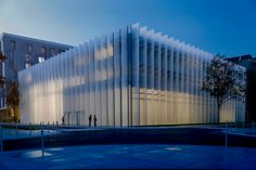 IMREDD, Nice-Mediterranean Institutre of Risk, the Enviroment and Sustainable development, designed by Marc Barani. The building is covered with large fixed blades made of opalescent , transparent glass. a perfect comunication between the indoor illumination and the glass facade