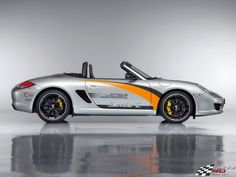 Porsche Boxster E: http://www.greenerideal.com/vehicles/0913-ferrari-and-the-hybrid-what-to-expect-from-the-future/