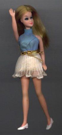 Dawn dolls.. I had one of these and I really enjoyed the Dawn dolls more than Barbies....these pretty little things were only about 5 inches tall.  The dress on this doll is original to Dawn; I remember it well!