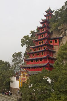 One of the cultural higlights of the Yangtze River cruise is this amazing pagoda, carved into the hillside high above the flowing river.  Shibaozhai Pagoda | Flickr - Photo Sharing!