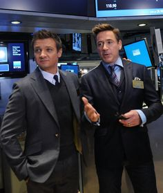 """Jeremy Renner and Robert Downey, Jr. attend Marvel Entertainment Executives Ring The NYSE Opening Bell In Celebration Of """"Marvel's Avengers: Age Of Ultron"""" at New York Stock Exchange on April 27, 2015 in New York City."""