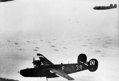 Consolidated B-24H Liberators of 486th Bombardment Group, US Eighth Air Force, flying over part of the Allied invasion fleet gathered off the Normandy coast, 6 June 1944. They were part of a force despatched on the morning of D-Day to bomb villages which had access roads to the beachheads running through them.