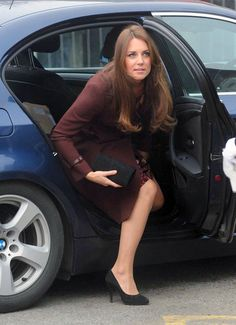 Kate Middleton Bundles Up Her Baby Bump For a Visit to Grimsby: Kate Middleton smiled at the crowd.