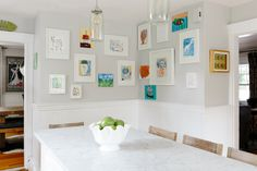 A wall of the children's artwork makes the kitchen feel like the heart of the home. Tour this entire awesome home!