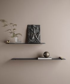 """Ferm Living has collaborated with Mario Tsai to create a series of """"flying"""" shelves, which seem to be mounted without the use of any fixtures."""