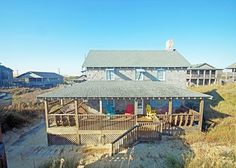 """The Beach House"" is a great Old Nags Head style beach house that sleeps 10.  It's an oceanfront with ocean views and has 4 bedrooms."