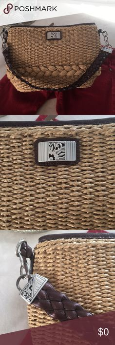 """Brighton woven bag New condition Brighton bag with sturdy woven body trimmed in brown leather and their trademark embellishments. Some wear to the shirt chain.  Cool leopard interior. Clean. No stains, holes etc. Approx 15x9x4.5"""". Brighton Bags"""
