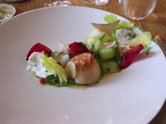 Glazed Norway scallop with vegetables, green strawberries, cranberries, walnuts and dill emultion by Chef René Redzepi at Noma Restaurant, Copenhagen.