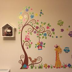 Animal jungle decal wall sticker and bird house shelf in little girl's room nursery