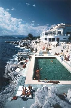 France Travel Inspiration - Guests by the pool at the Hotel du Cap Eden-Roc, Antibes, #France, 1976 | Shop at surfaceview.co.uk