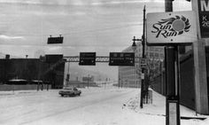January 9, 1977: Snow Won't Stop Those With Deep Determination...a car makes solitary way out Columbia Parkway from Fifth Street, downtown Cincinnati, Ohio.