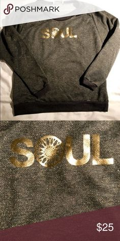 SoulCycle cropped sweatshirt Barely worn SoulCycle cropped sweatshirt. Can be worn sporty for a work out or,casual with skinny jeans and some brown combats Sweaters Crew & Scoop Necks