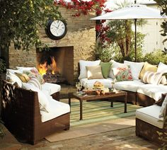I love these curved sectionals by Pottery Barn for my outdoor seating & a colorful striped outdoor rug!